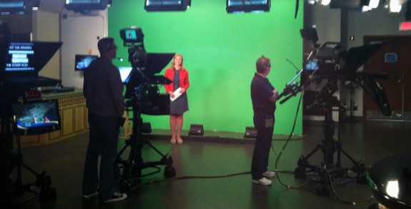 10:15 pm: Jennifer Gannon stands in front of the green screen.