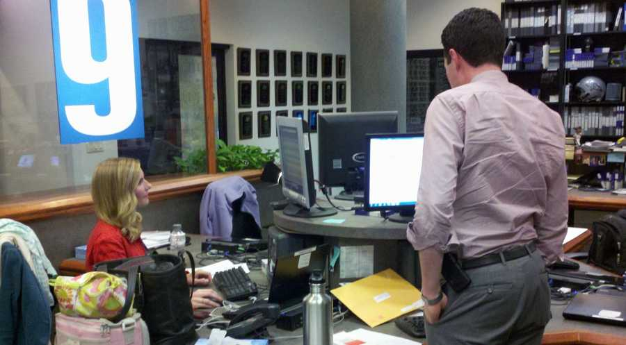 10:45 pm: Reporters Jennifer Gannon and Adam Sexton in between the 10 p.m. and 11 p.m. shows.