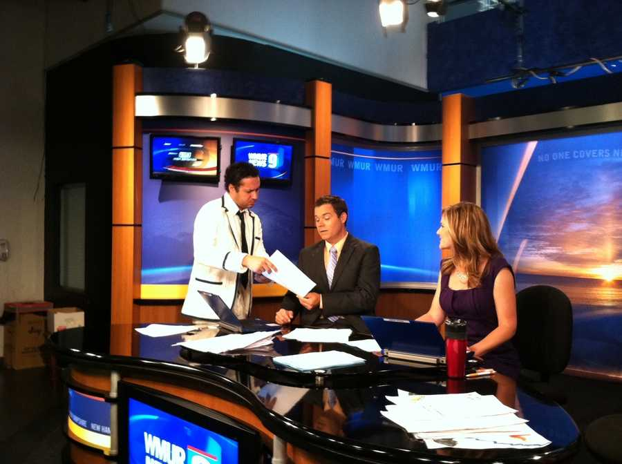 Richard Bourne bringing Sean McDonald and Erin Fehlau new scripts during the show.