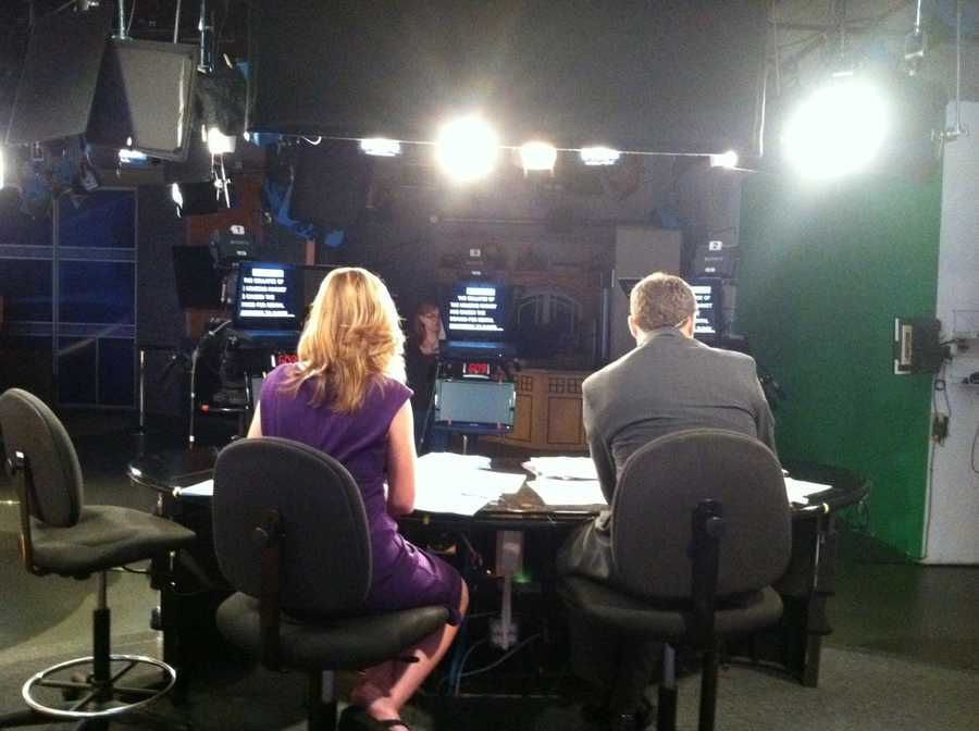 Back shot of Erin Fehlau and Sean McDonald during a commerical break on Daybreak.