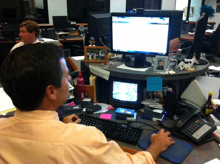 Sean McDonald and Ray Brewer preparing for the show in the newsroom.