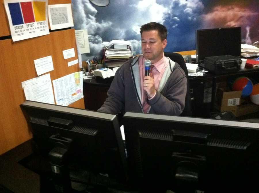 Kevin Skarupa recording radio forecasts.