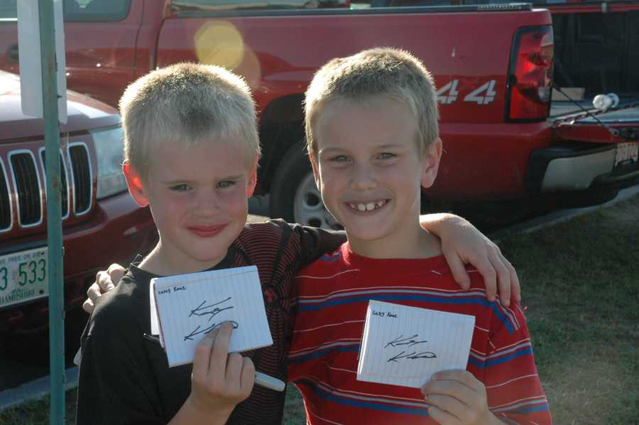 Austin Baker, 5, and Logan Baker, 7, of Epsom show off autographs from Kahne.