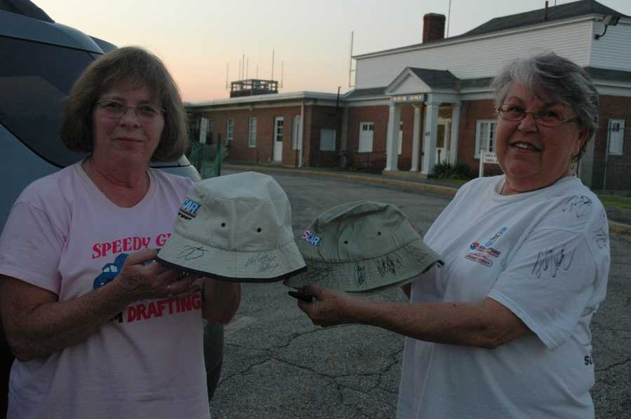 Jan Eleftheriou of Loudon (pink shirt) and Nancy Bottcher of Loudon show off their newly-signed hats.