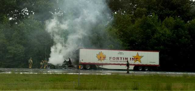 A truck caught fire along I-93 in Hooksett Saturday morning.