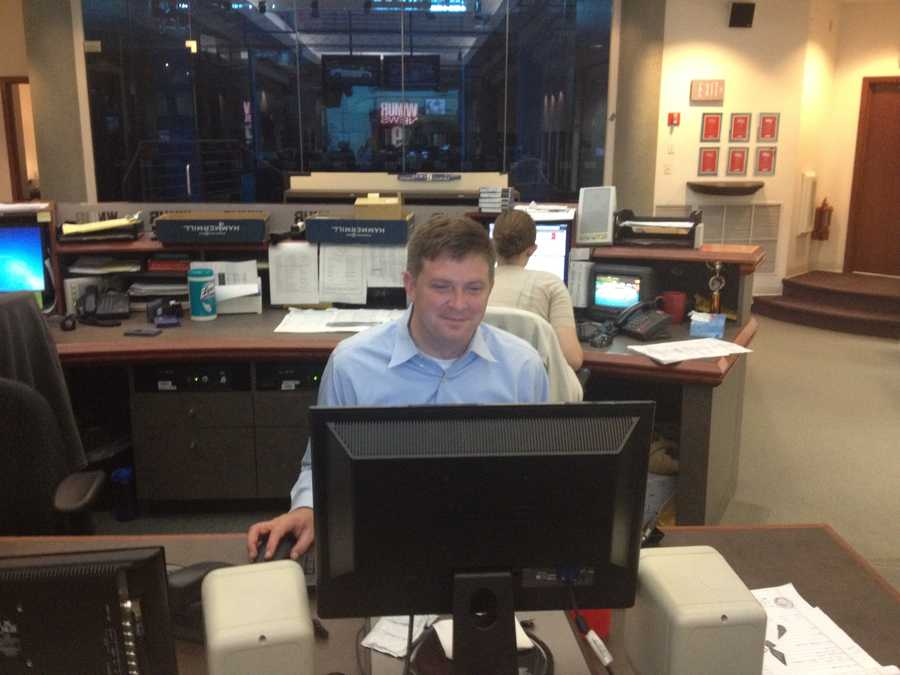 Reporter Mike Garrity prepares for the noon show, which he will be anchoring.