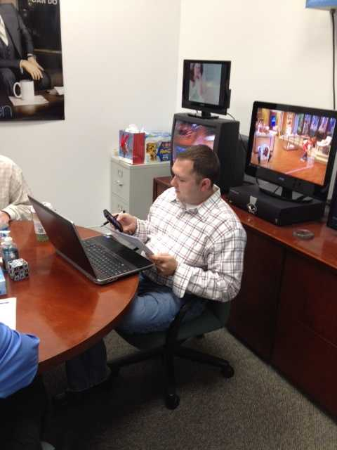 News 9 staffers, such as assistant news director David Hurlburt, prepare for the morning news meeting.