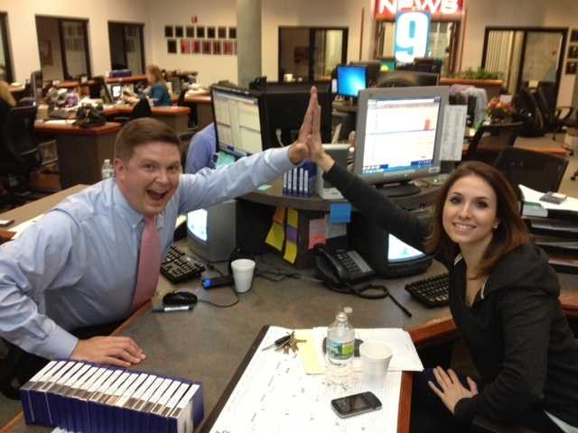 Reporter Mike Garrity celebrates the successful completion of a story with producer Mariella Vaudo.
