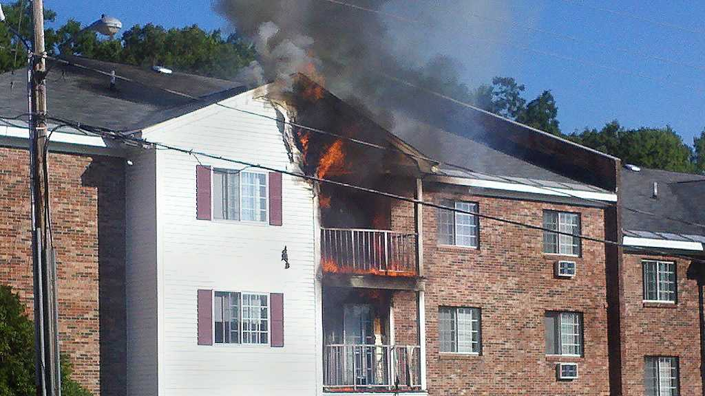 Firefighters in Manchester battle a blaze at an apartment building fire Sunday morning.