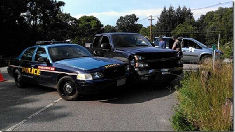 A Charlestown police cruiser and a truck collided Friday afternoon on Route 12, said state police investigators.
