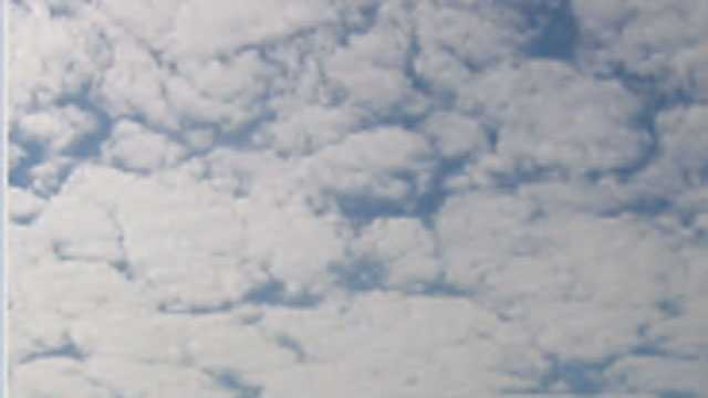 At times, middle-level clouds can totally or partially cover the sky. This is a shot of an altocumulus cloud (M3).
