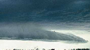 A shelf cloud usually forms in front of a thunderstorm or a cold front. The cloud appears low in the sky and horizontal-shaped.
