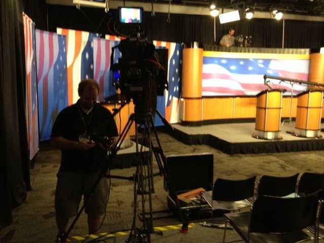 WMUR photographer Chris Shepherd checks his cameras ahead of the debate.