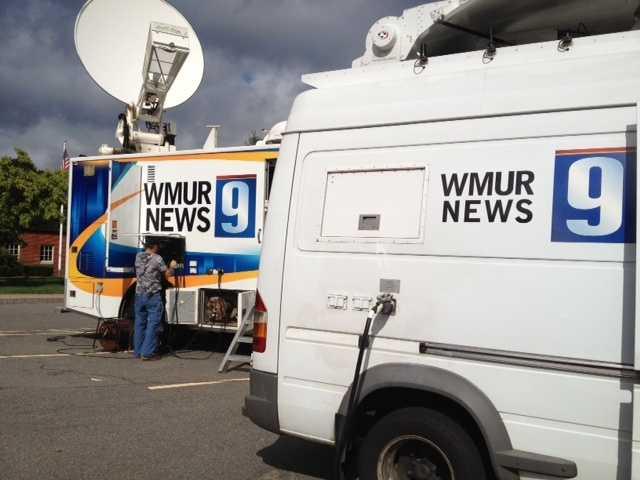 Truck operators set up the WMUR satellite truck ahead of the debate.