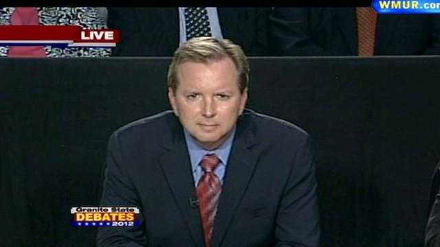 News 9's Josh McElveen delivers a question to the candidates.