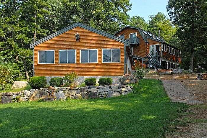 This $1.27 home on the lake in Alton offers a sandy beach, boat dock, boat house with lifts, 4 bay detached garage with car lift and a 1000+ square foot finished room above, indoor 16 x 32 heated pool with child safe auto cover, hot tub, wet bar, patio with a waterfall landscape in the back ground.