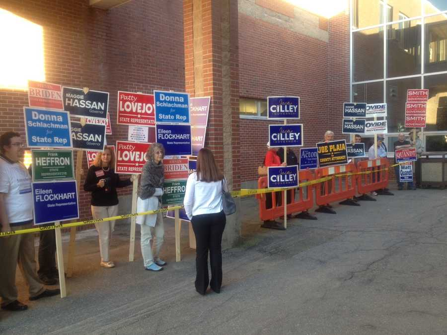 Supporters line outside a voting location in Exeter.