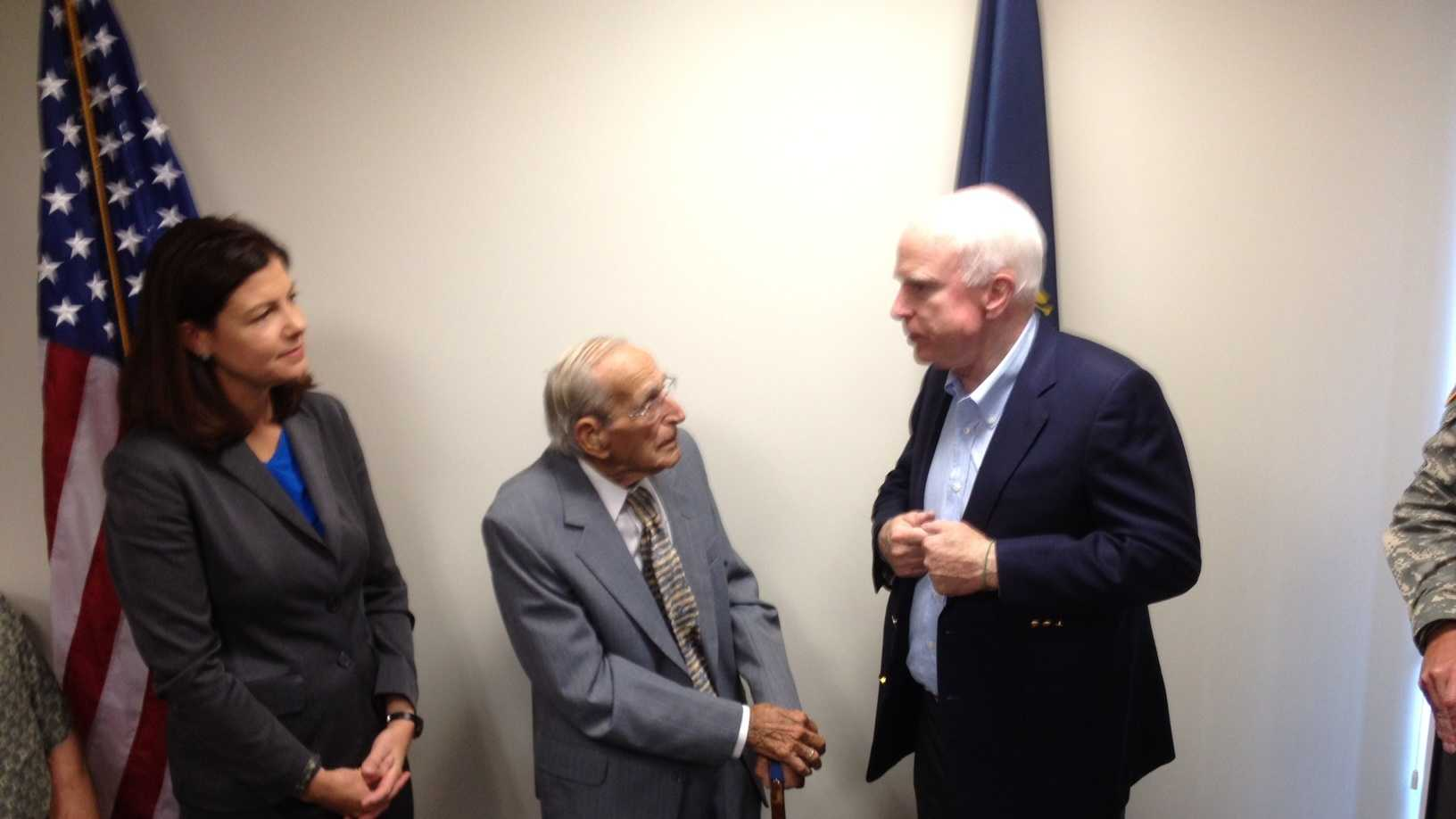 Sen. John McCain joined Sen. Kelly Ayotte to hand service medals to Gerard Hebert, a World War II veteran.