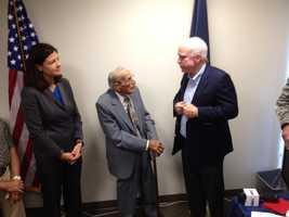 Sen. John McCain joined Sen. Kelly Ayotte to hand service medals to Gerard Hebert, a World War II veteran.