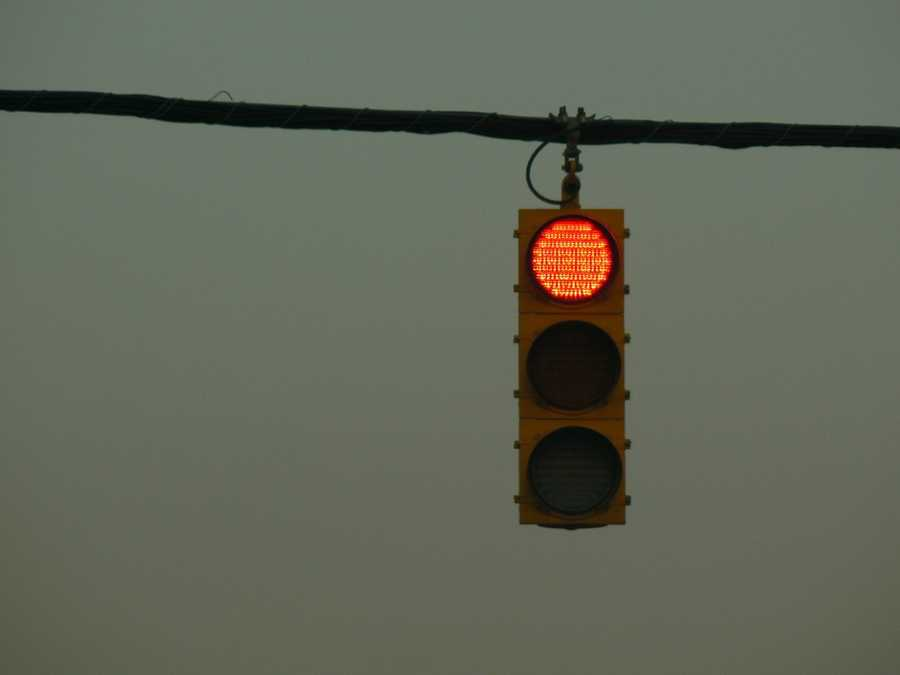 True or False? It is OK to make a right turn at a red light when a steady or flashing walk signal is being displayed as long as there are no pedestrians in the crosswalk.