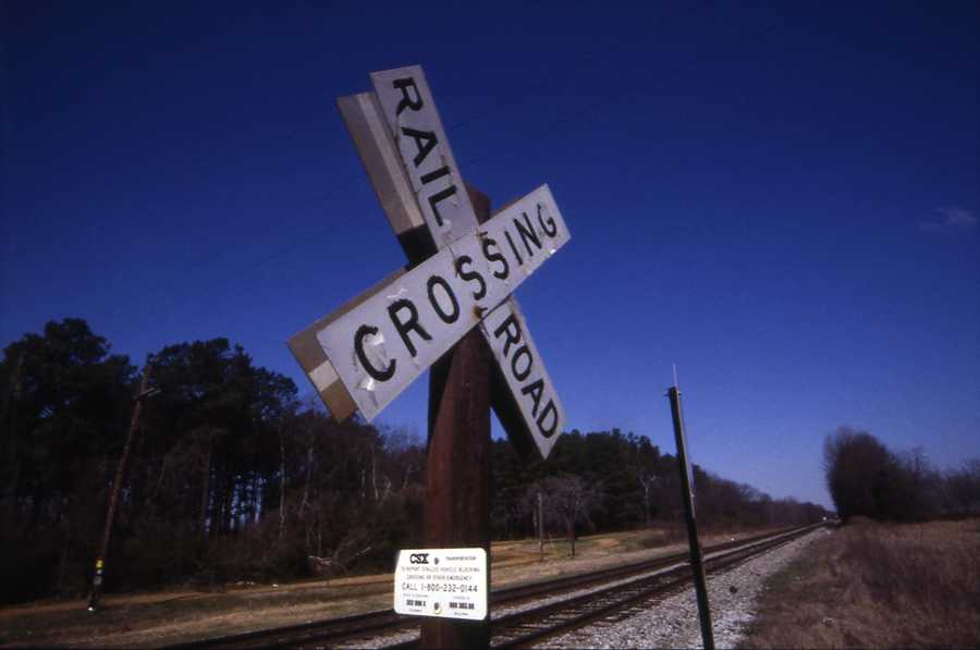 Why are drivers encouraged to avoid shifting gears when crossing railroad tracks?