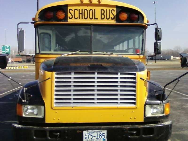 When approaching a school bus that is letting off or picking up passengers, how many feet from the bus must you stop your vehicle?