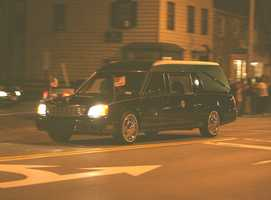 A funeral procession begins to pass by on the street you're trying to turn onto. What can you do?