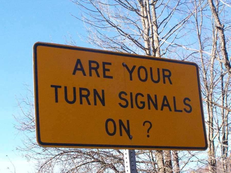 How far ahead of a turn must you activate your turn signal?