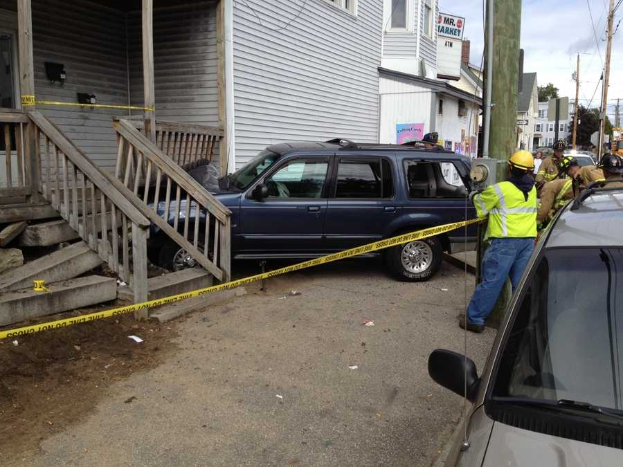 The SUV struck the porch of this multi-family home.