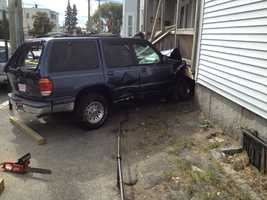 An SUV crashed into this home on Lincoln Street in Manchester on Monday morning.