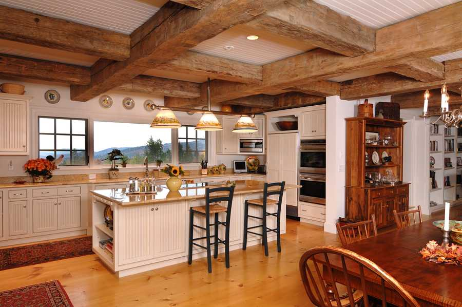 The kitchen features state of the art Wolf appliances, large country pine flooring and granite countertops.