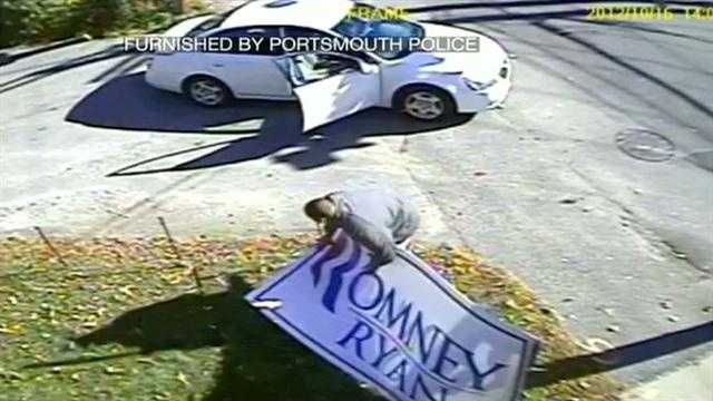 Police in Portsmouth are looking for the man who was caught on tape targeting one of Republican presidential candidate Mitt Romney's campaign signs.