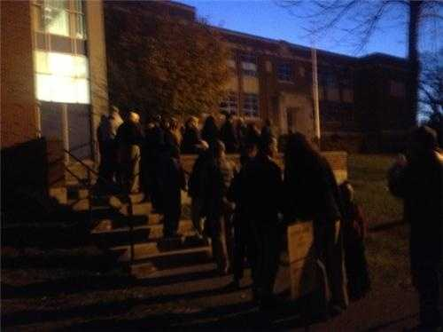 The voters lined up before sunrise outside a polling location in Manchester.
