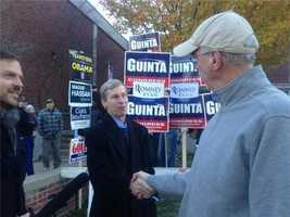 Gov. John Lynch shakes hand with voters outside of a polling location in Manchester.