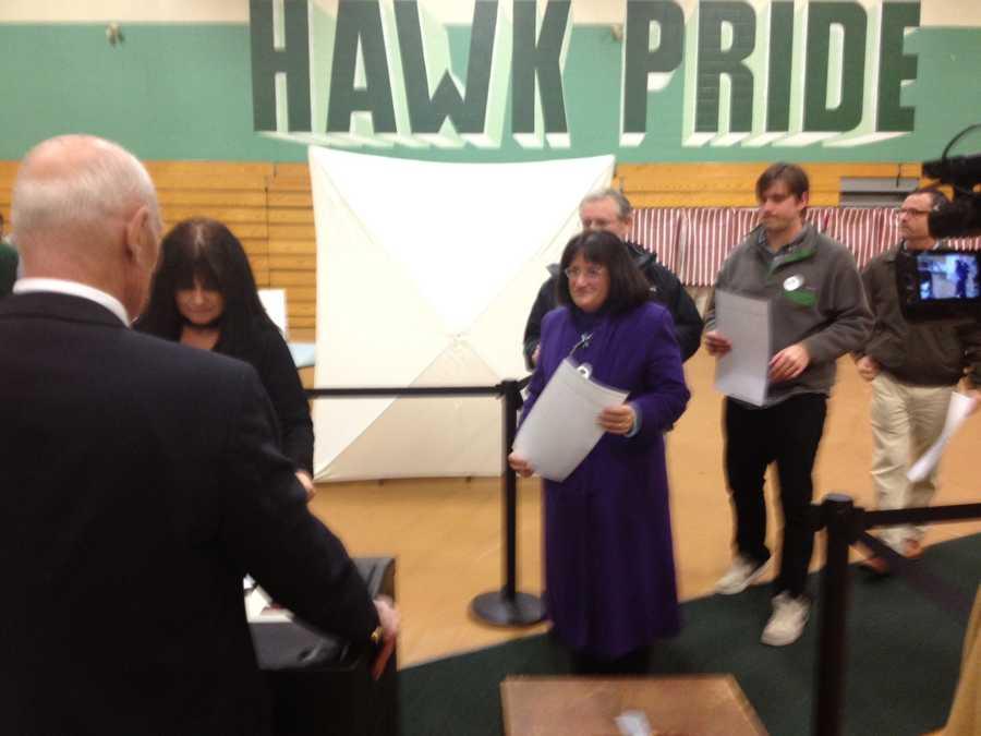 Annie Kuster voting.