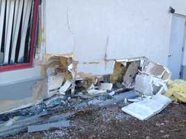 A vehicle crashed into an auto repair shop in Manchester some time before Monday morning and fled.