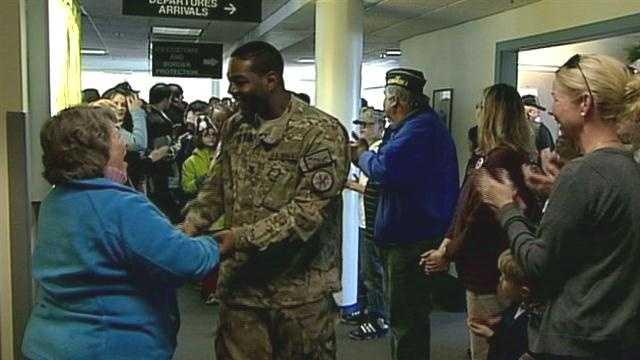 Pease greeters welcome troops