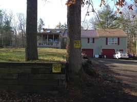 No trespassing signs were posted at the home of Helen Nault, Dow's mother, on Monday, Dec. 3, 2012.