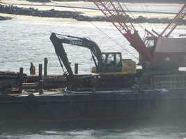 Last week, the excavator fell into 16 feet of water under the Hampton Harbor Bridge after a cable snapped.