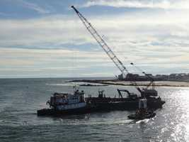 The excavator was being used as part of the Army Corps of Engineers' dredge of the harbor.