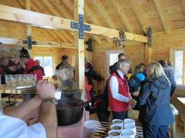 A ceremonial ribbon-cutting for the all-new Telegraph T-Bar and rustic warming hut at the top of the Mount Stickney Glades was held.