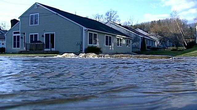 Water Main break causes flooding in neighborhood.