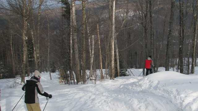 Skiers at Bretton Woods enjoyed powder in the glades after the patrol dropped ropes on 10 trails by noon, Monday. Bretton Woods was among seven ski areas that planned to be open on Christmas Day.