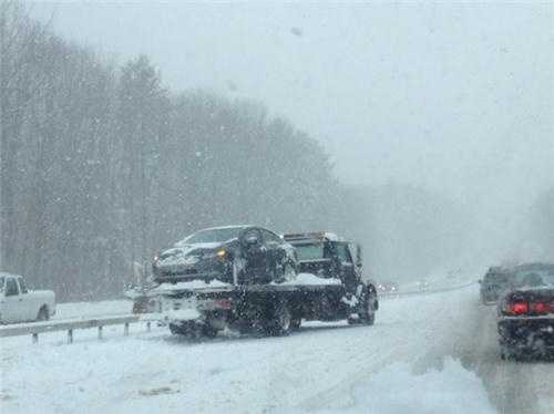A car spun out near Exit 6 on the Everett Turnpike.