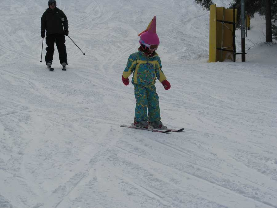 Taylor Cooldige, 4, of Georgetown, Mass. bombs down the trails with her family, at Gunstock, in Gilford, Friday, and said she really was having fun in the 12 to 15 inches of new powder snow. The region's ski resorts were packed, Friday and expect a very strong long weekend of business thanks to all the new natural snow.