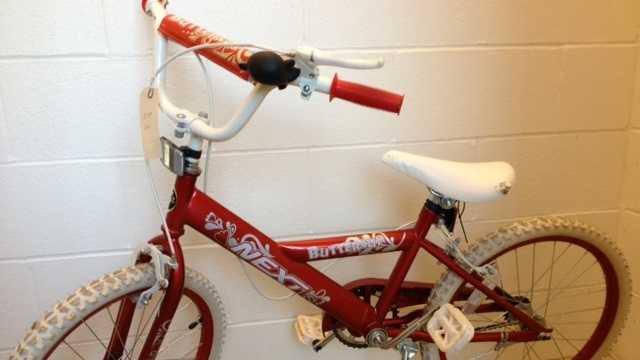 Manchester police say a child abandoned this bike after after a woman began calling 911 on her behalf. They are trying to locate the child.