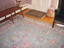 Area rugs can help reduce floor drafts and create a sense of warmth in a room.