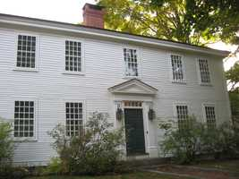 Wonderful example of traditional wood storm windows in use on a late 18th century home.