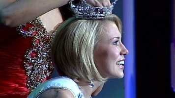 Tears stream down Megan's face as the crown is placed on her head.