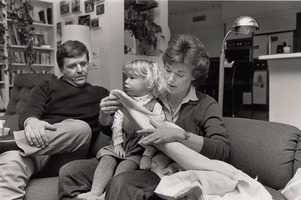Chet Curtis and Natalie Jacobson in their Needham home with daughter Lindsay.